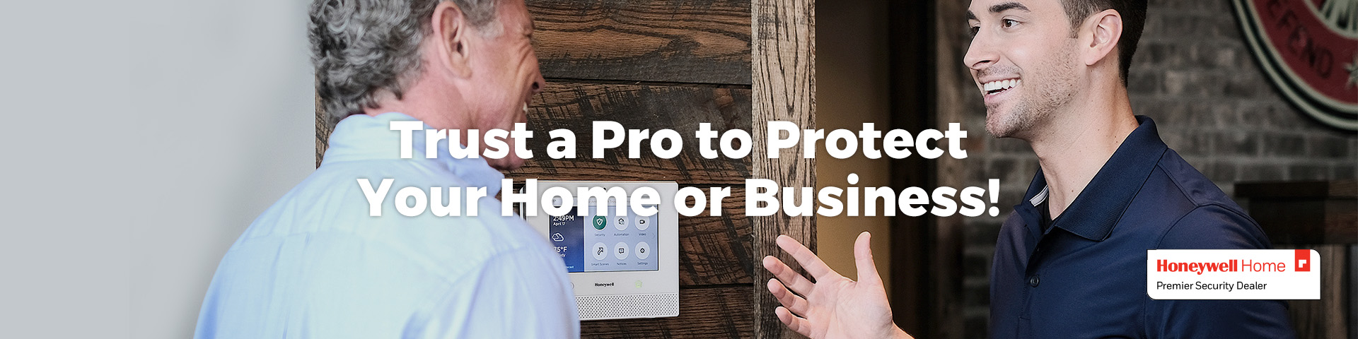 Business owner talking with professional security installation technician