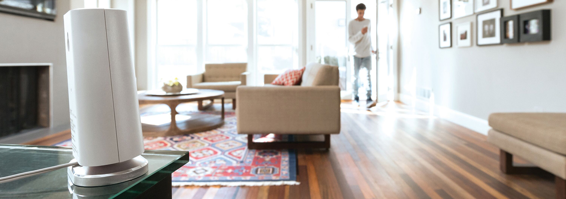 Man with cell phone walking through living room