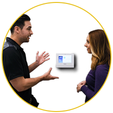 Man explaining security system to woman